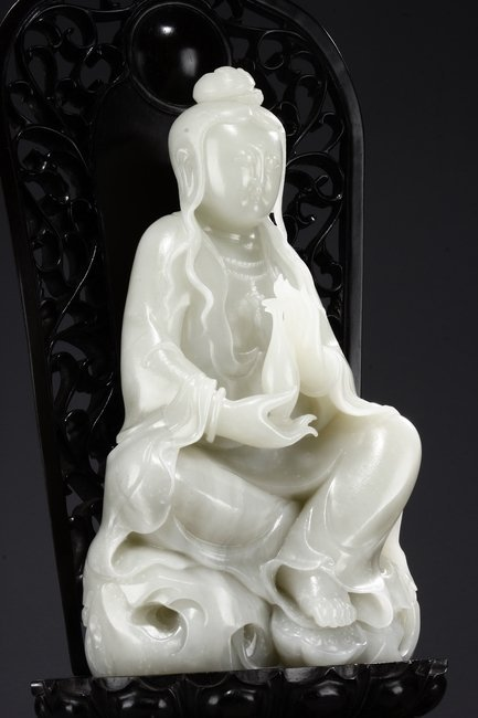 A LARGE WHITE JADE 'GUANYIN' WITH ZITAN BASE - 6