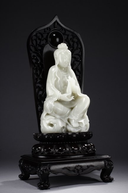 A LARGE WHITE JADE 'GUANYIN' WITH ZITAN BASE - 7