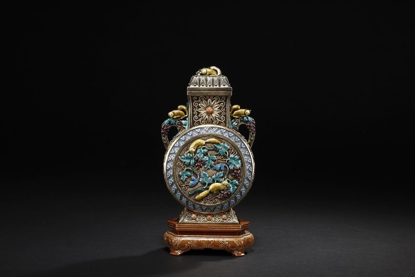 A SILVER FILIGREE AND ENAMELED MOON FLASK