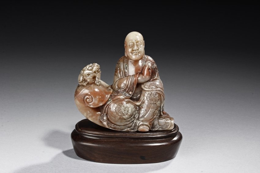 A SHOUSHAN CARVED SEATED LUOHAN