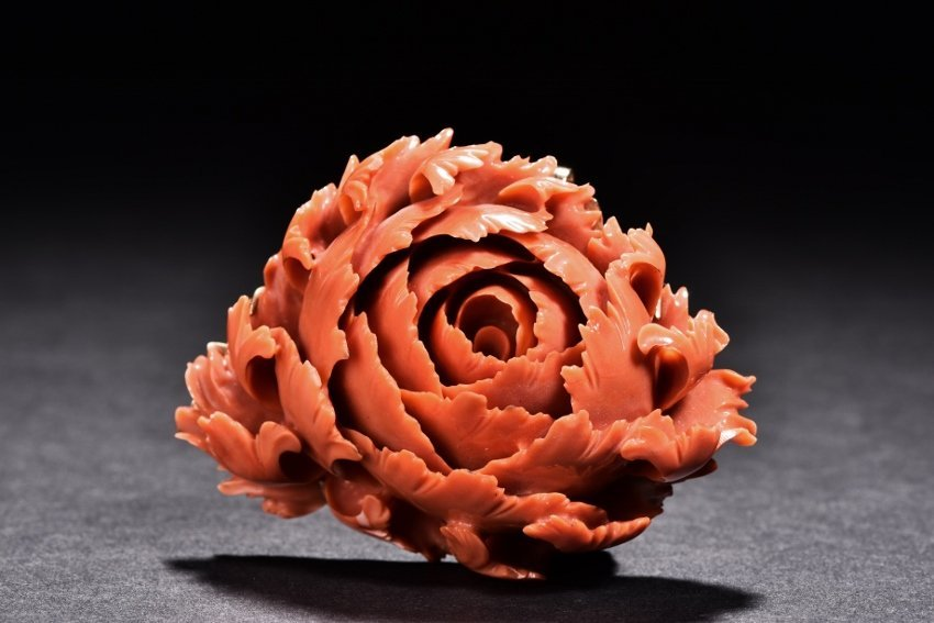 A CORAL CARVED PEONY BROOCH