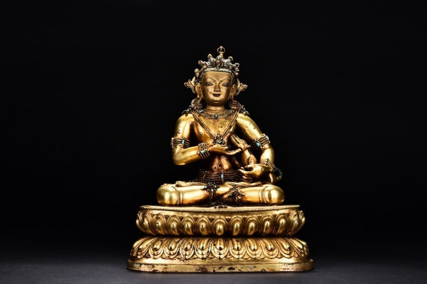 A GILT-BRONZE FIGURE OF TIBETAN JAMBHALA