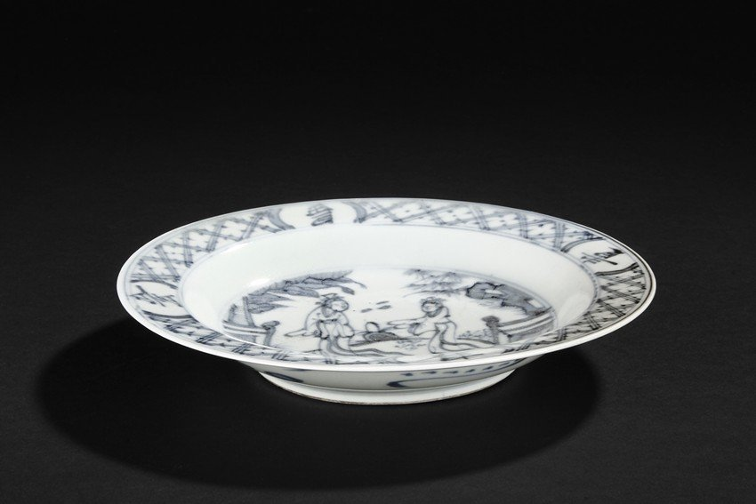 A BLUE AND WHITE 'FIGURES' DISH