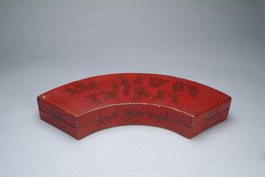 A CHINESE WOOD LACQUER 'CHILDREN' BOX