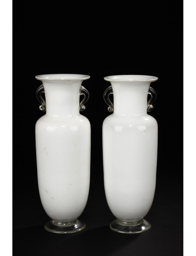 A PAIR OF WHITE GLASS ROULEAU BOTTLES