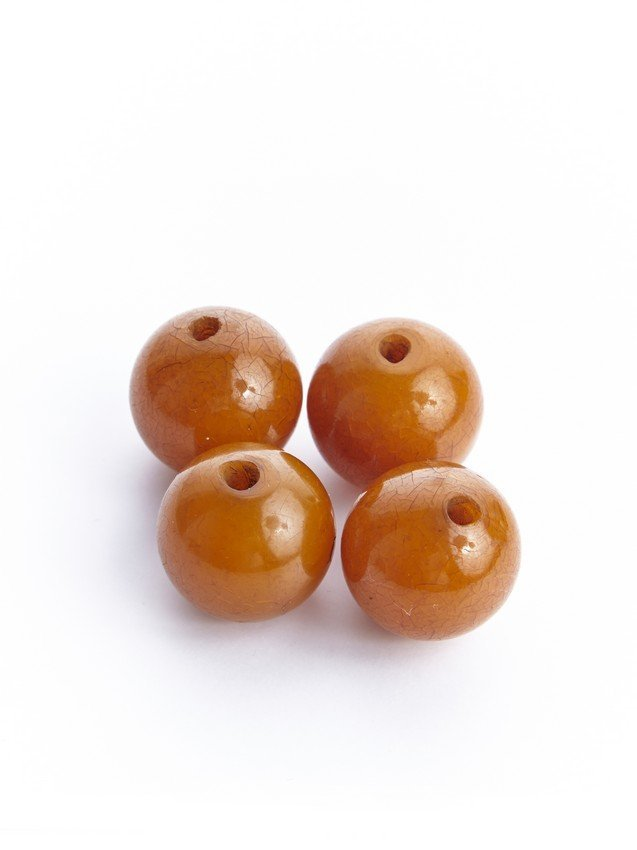 A SET OF FOUR AMBER BEADS