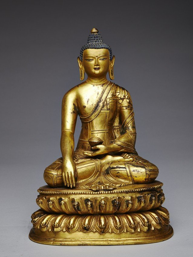 A LARGE GILT-BRONZE FIGURE OF SEATED SHAKYAMUNI