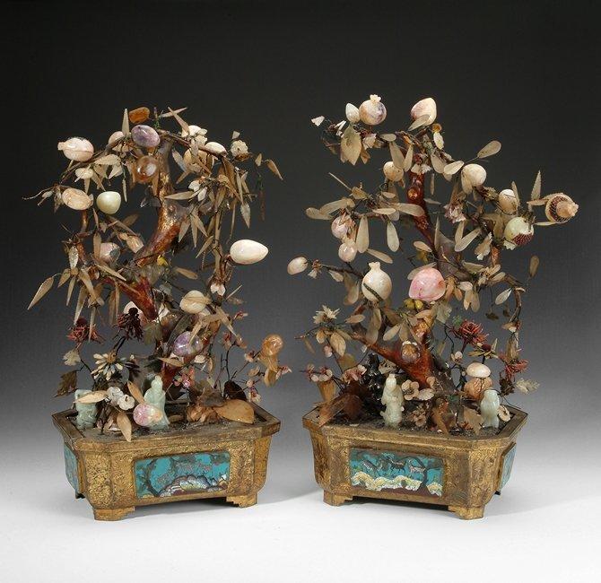 A PAIR OF JADE AND HARDSTONE TREES IN ENAMEL JARS