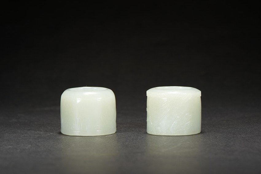 TWO WHITE JADE CARVED ARCHER'S RINGS