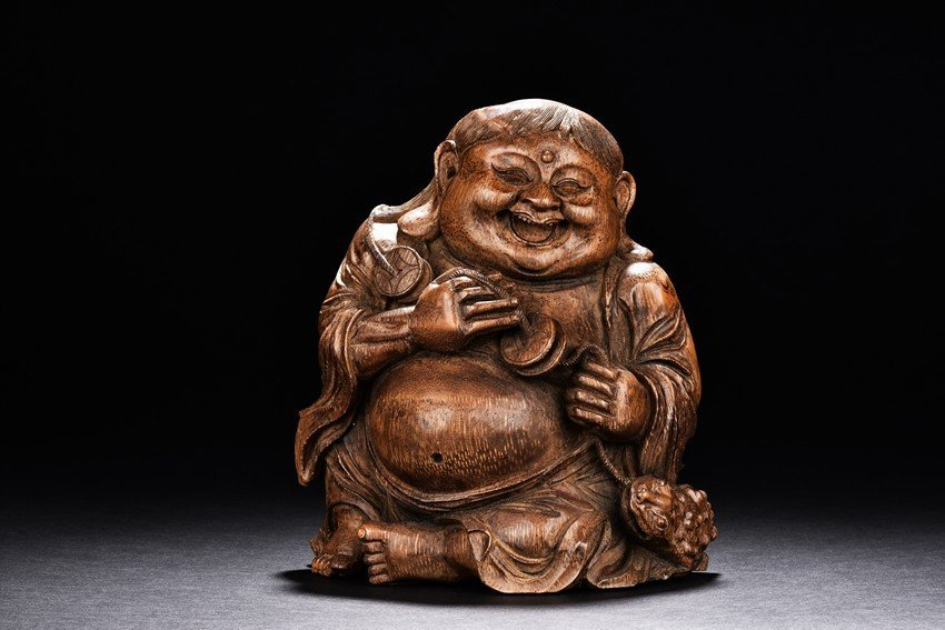 A BAMBOO CARVED FIGURE OF LIU HAI AND TOAD