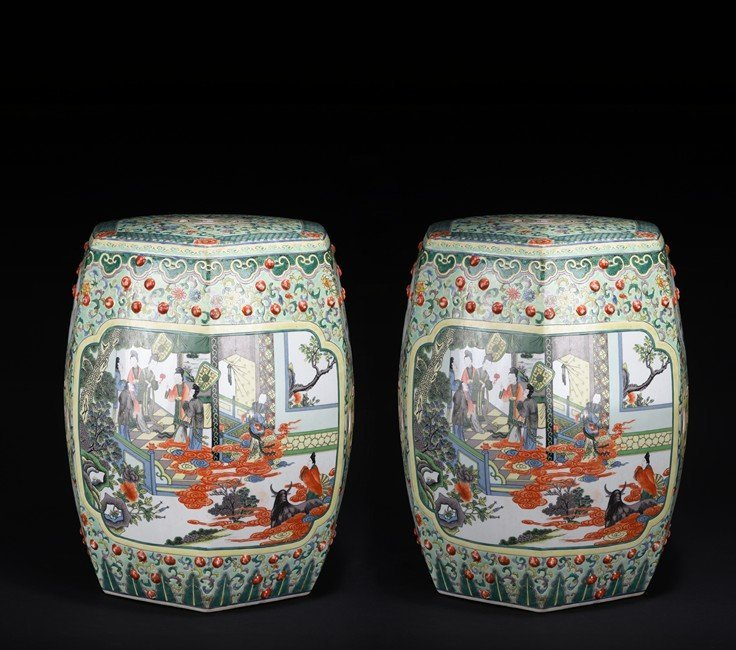 A PAIR OF FAMILLE ROSE 'FIGURES' STOOLS