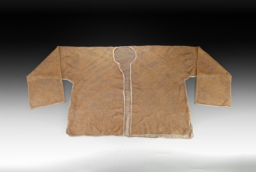 A RARE CHINESE VEST STRANDED FROM WHEAT STRAW