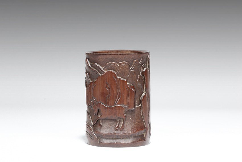 A CARVED BAMBOO 'LANDSCAPE AND FIGURE' BRUSH POT