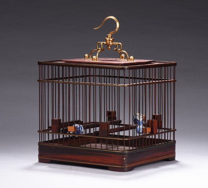 A SQUARE ROSEWOOD CARVED BIRD CAGE