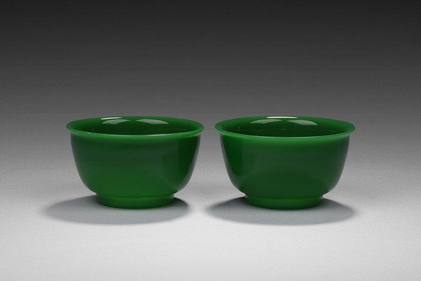 A PAIR OF GREEN PEKING GLASS BOWLS
