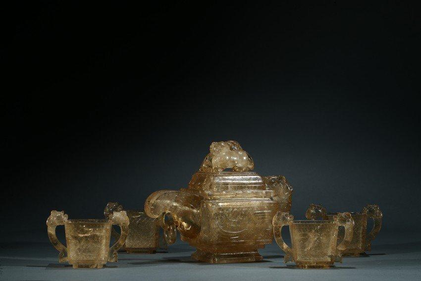 A SET OF FIVE SMOKY QUARTZ TEAPOT AND CUPS