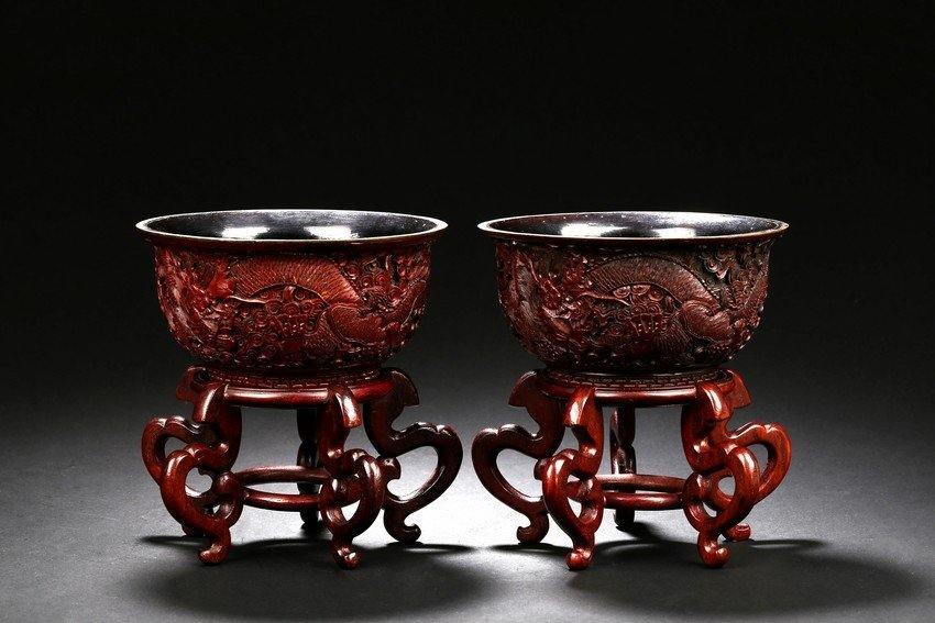 A PAIR OF CINNABAR LACQUER DRAGON BOWLS WITH STAND