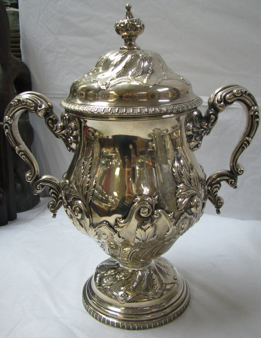 1018: STERLING SILVER TWO HANDLED CUP & COVER