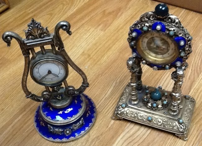 23: Two continental enameled & jeweled silver clocks