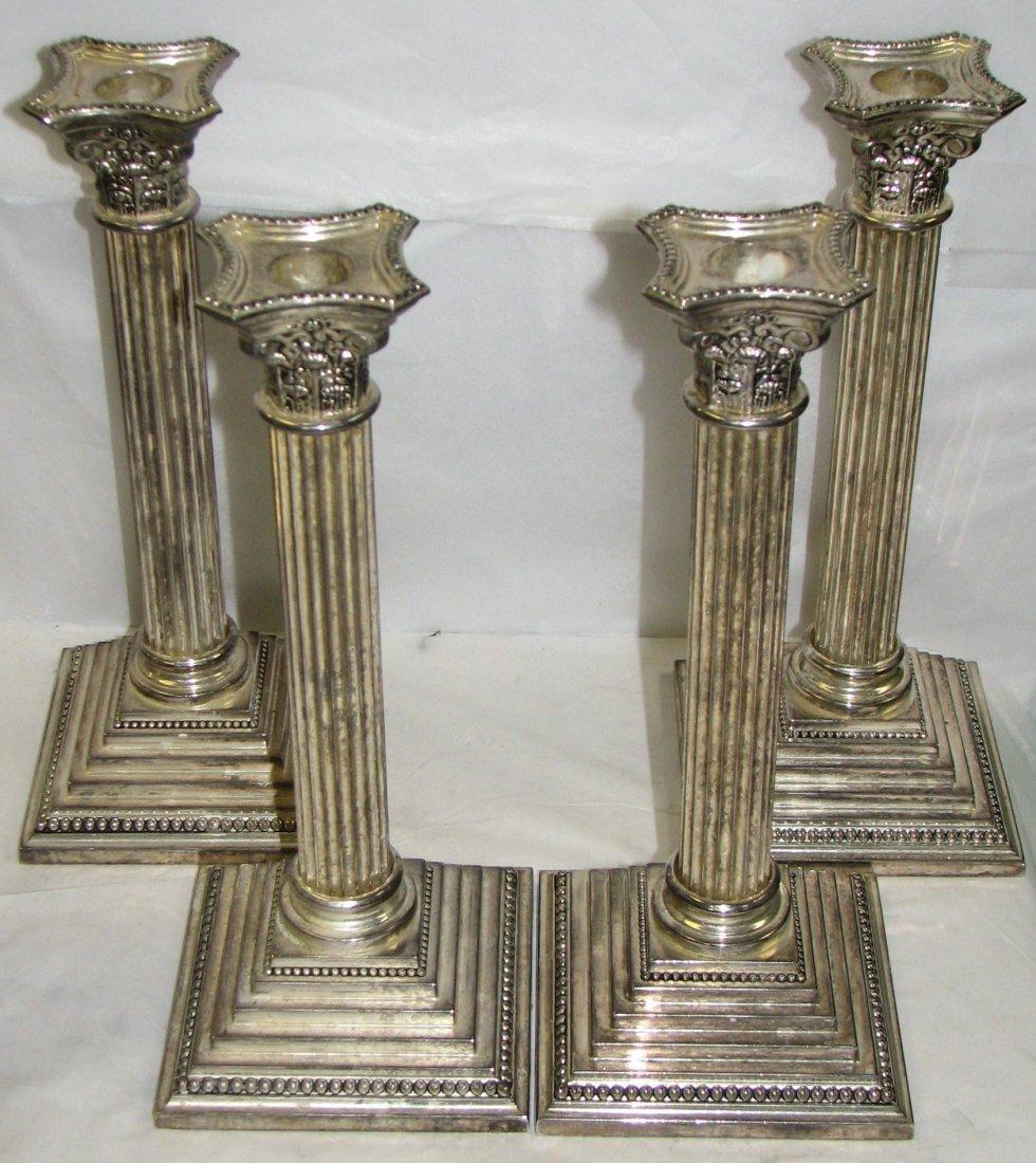 SET OF FOUR CORINTHIAN COLUMN CANDLESTICKS