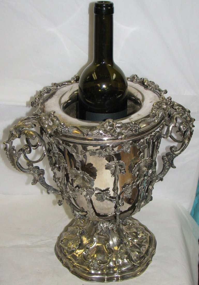 LARGE SILVER WINE COOLER WITH VINE DECORATION.