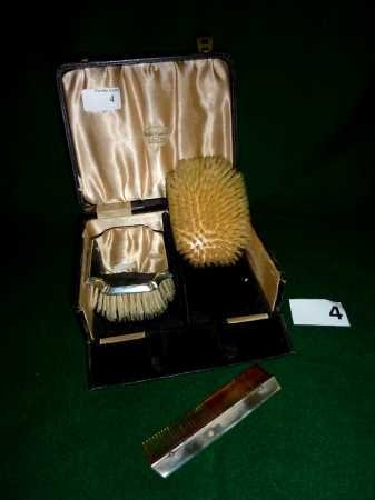 4: A cased set of silver hallmarked clothes brushes and