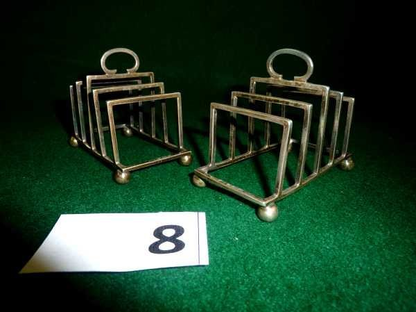 8: Pair of small silver hallmarked toast racks on bun f