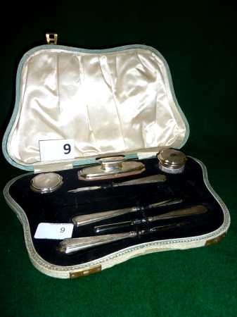 9: A cased silver hallmarked manicure set (lacking scis