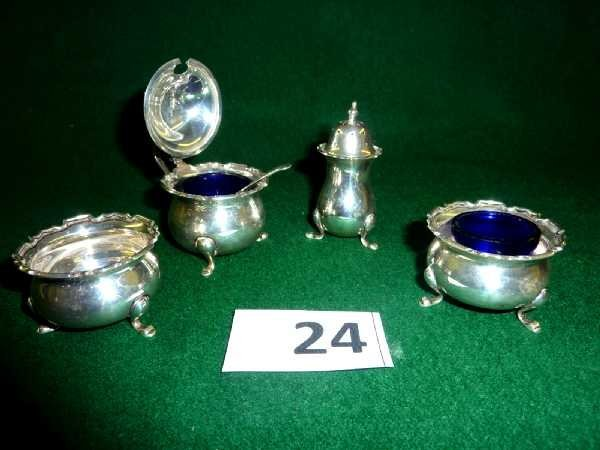 24: Four piece silver hallmarked cruet set comprising o