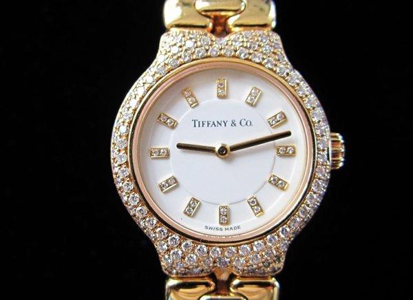 165: 18kyg Ladies Tiffany and Co. Diamond Watch