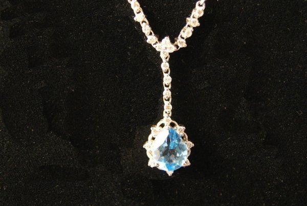 20: 14kwg Aquamarine and Diamond Pendant