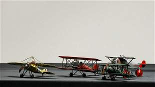 Collection of Four Metal Biplanes