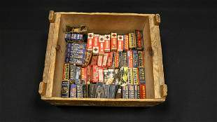 Collection of Vintage Spark Plugs and Wooden Crate