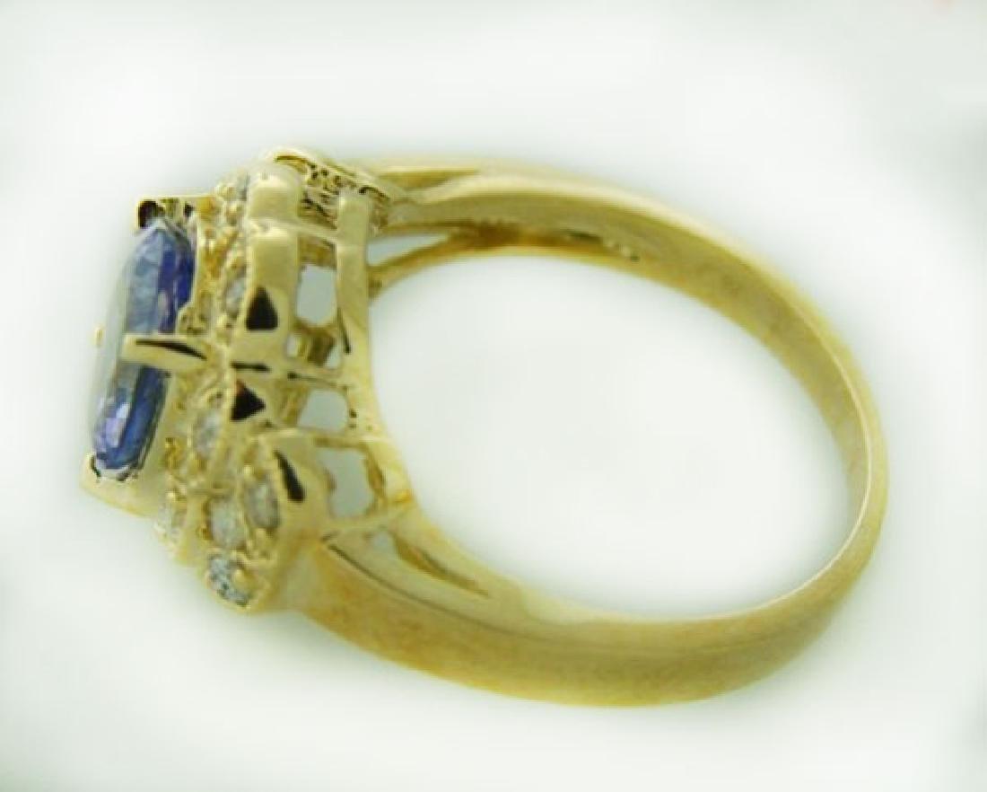 Tanzanite Ring: 3.60 Carat & .42 Carat 14K Y/g - 2