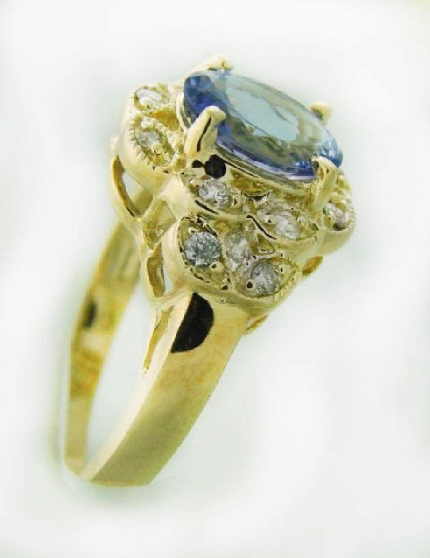 Tanzanite Ring: 3.60 Carat & .42 Carat 14K Y/g - 3