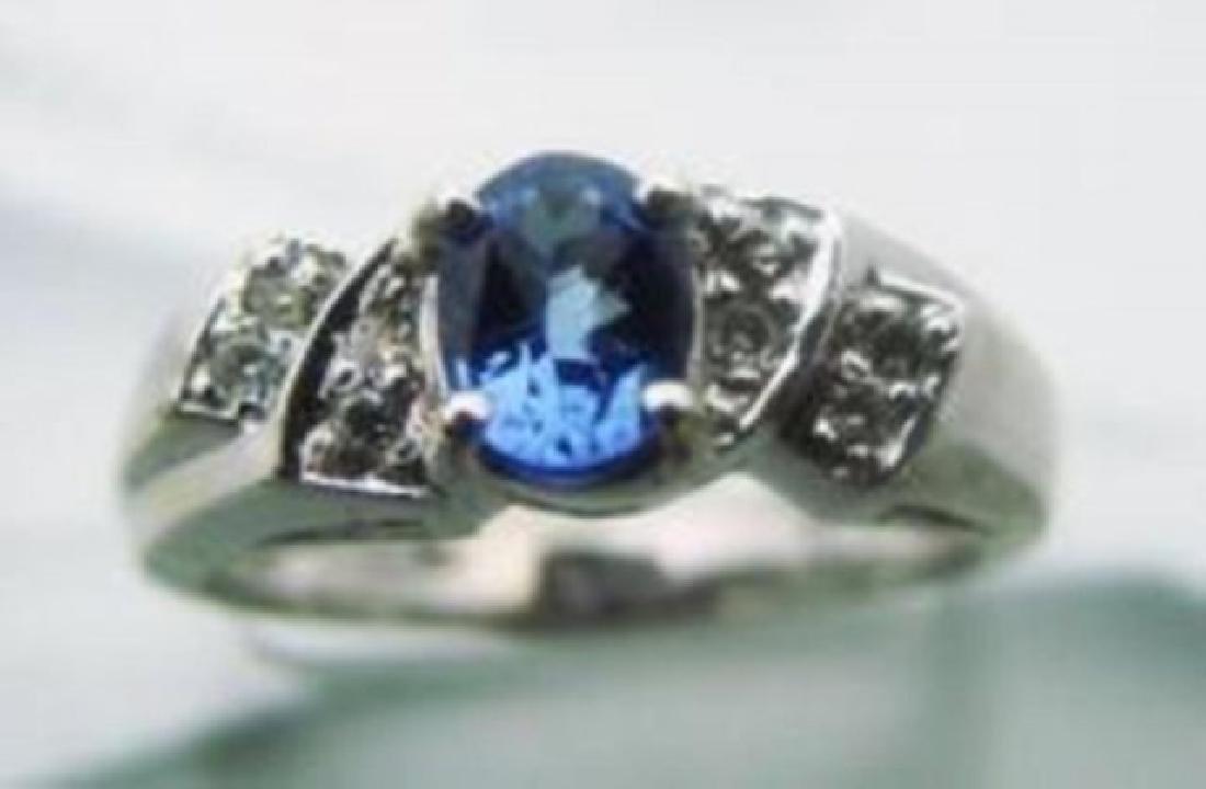 Tanzarnite: 1.10CT, Diamond: .25CT Ring 14k W/G