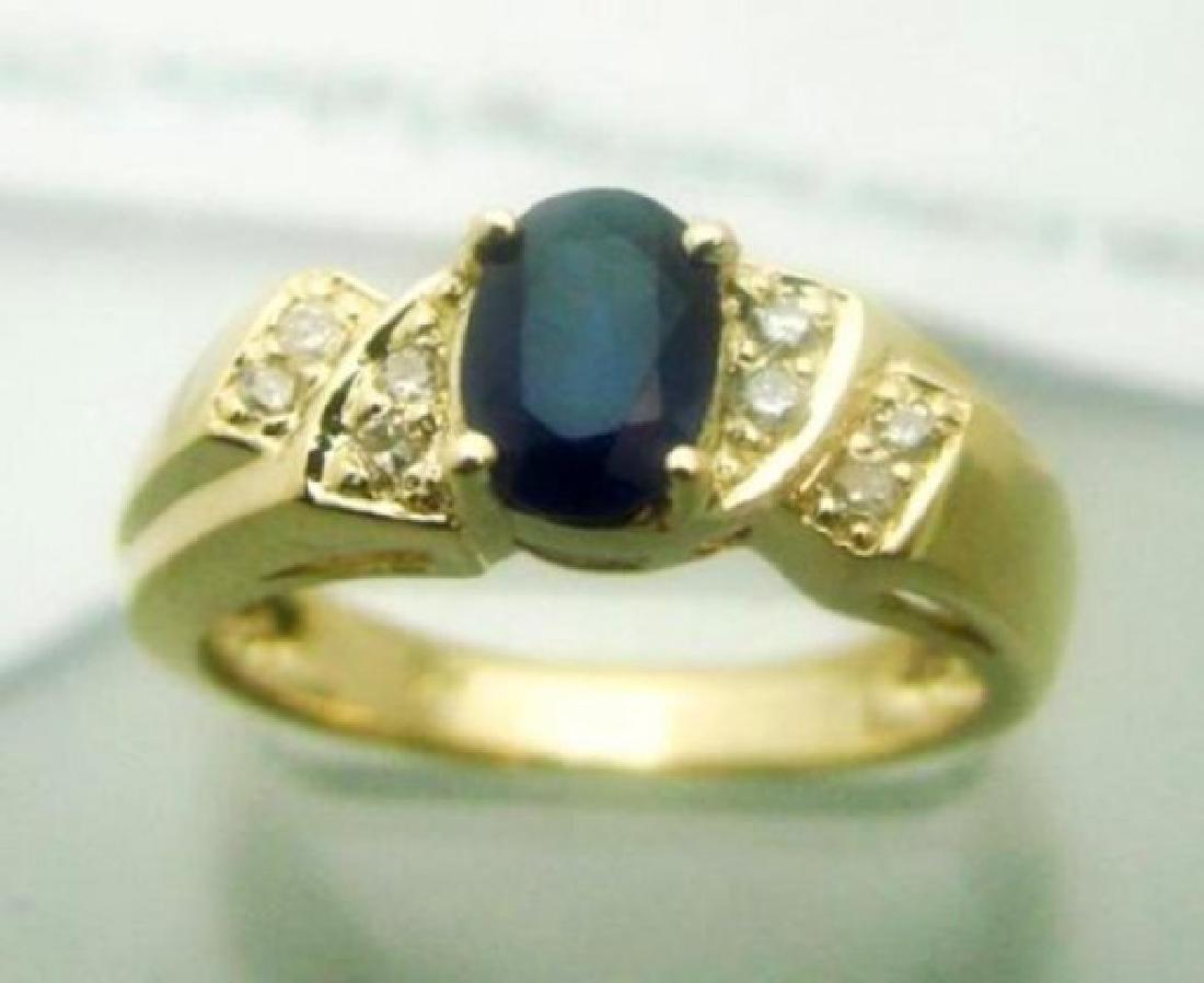 Blue Sapphire: 1.05CT, Diamond: .25CT Ring 14k Y/g