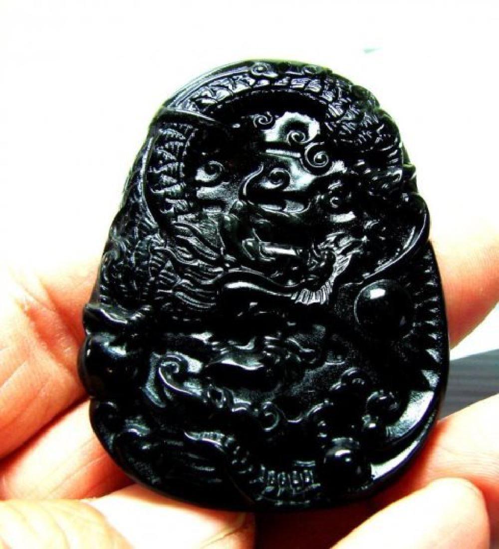 Onyx carving Dragon 114.45Ct 55x40x6.4mm