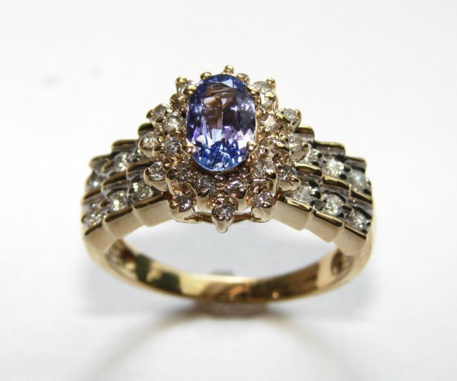 696: Tanzanite Ring: 1.80 Ct & Diamond: .80CT 14k Y/G