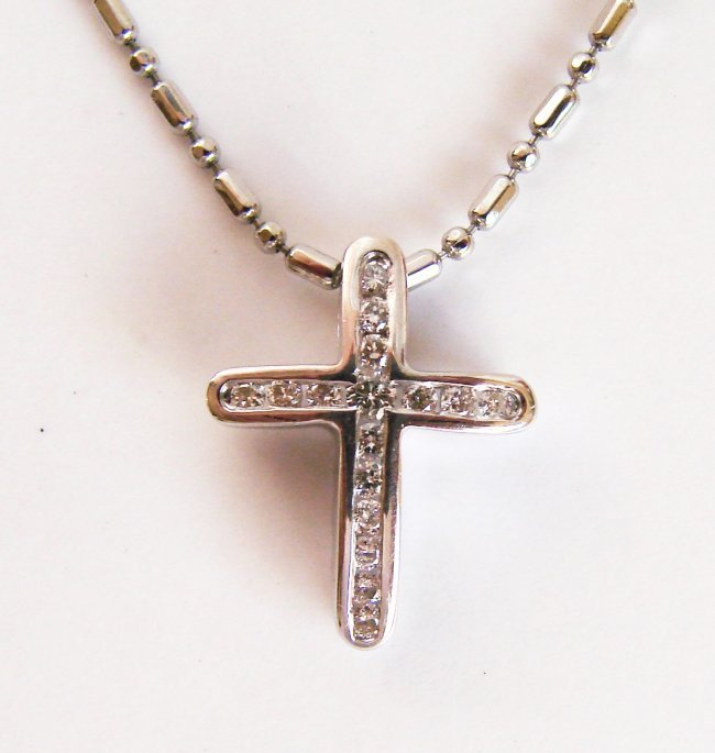 1066: Diamond Cross Pendant: .35 Carat 14k W/g