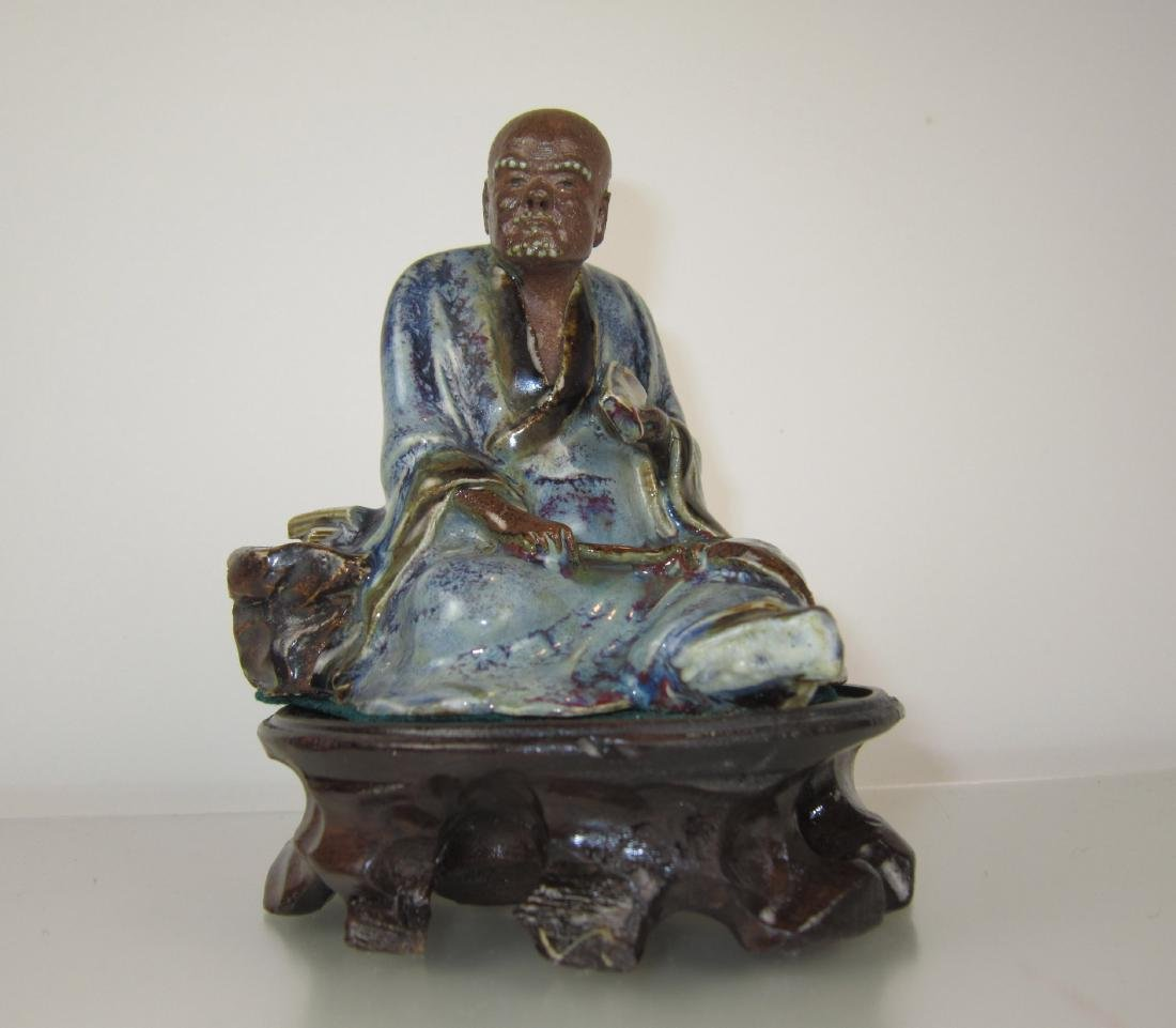 A Chinese Flambe-glazed Porcelain Buddha Figure