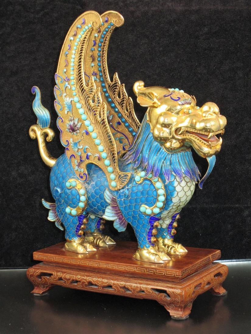 A Large Chinese Gilt Enameled Silver Flying Beast