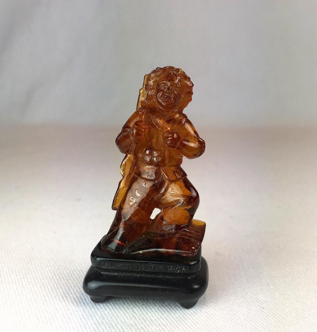 A Small Carved Amber Figure - Chinese Soldier