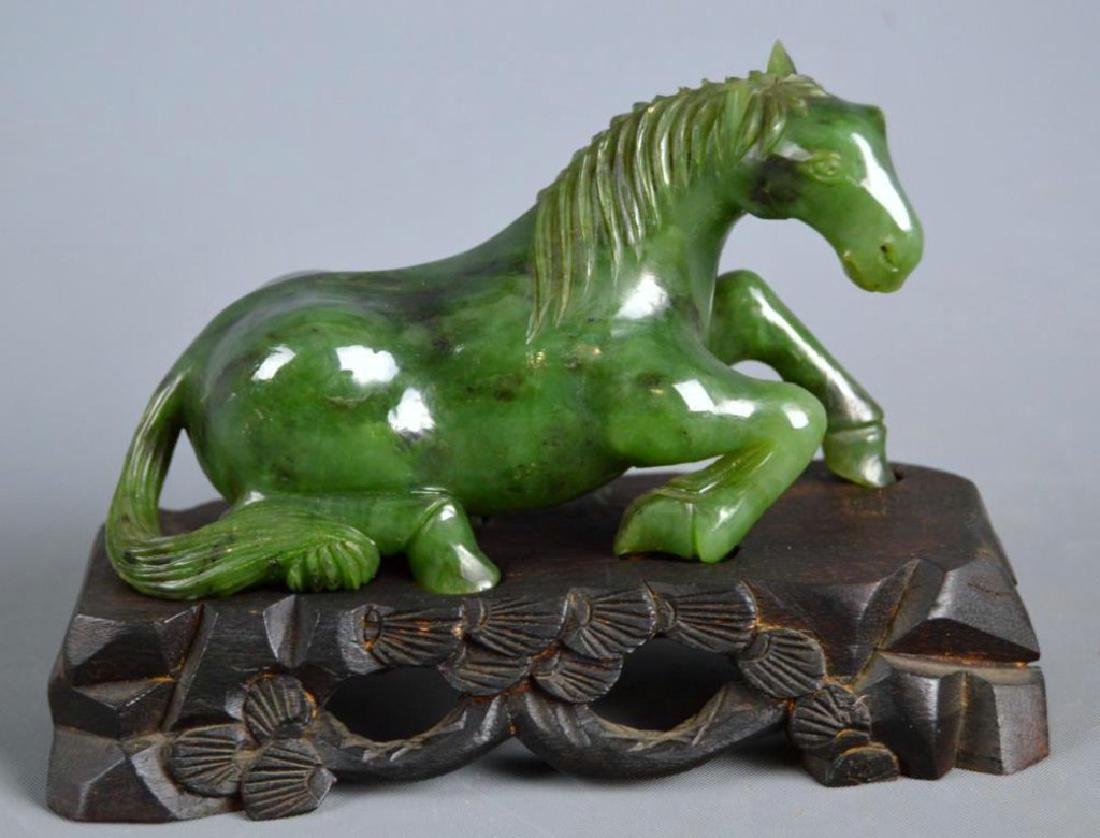 A Fine Chinese Carved Spinach Jade Horse