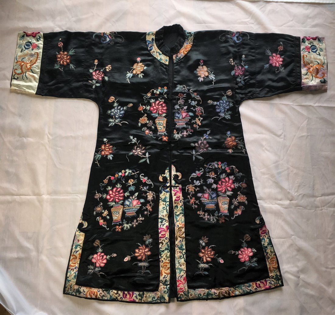 A Chinese Embroidered Silk Robe with Purple Ground