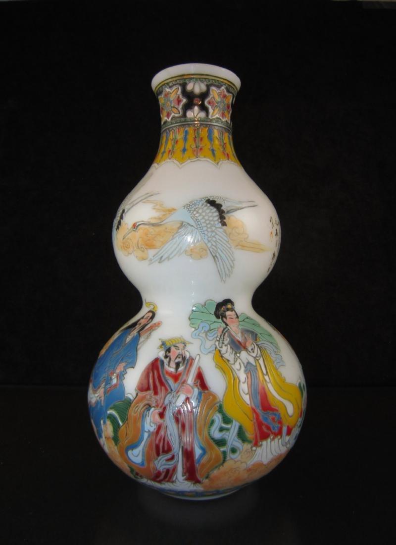 A Enameled Milk Glass Guard Vase