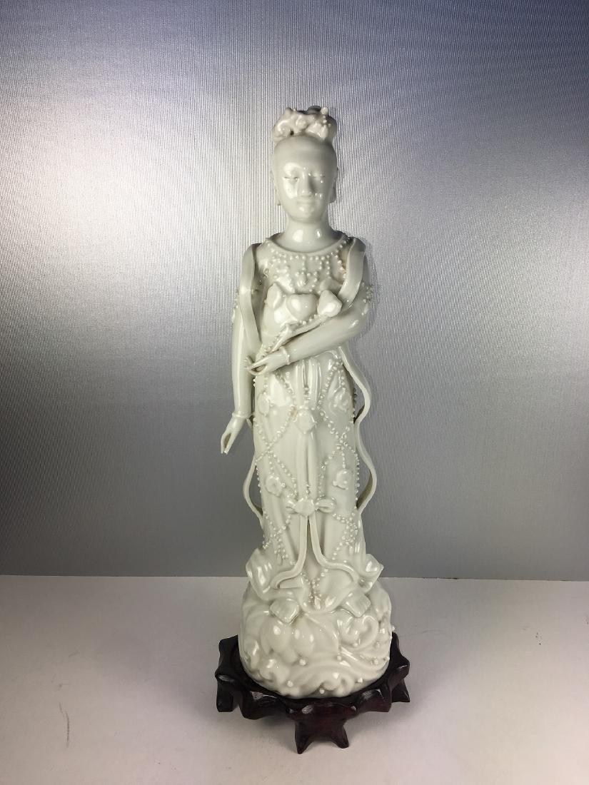 A Blank-de-Shine Figural of Guanyin