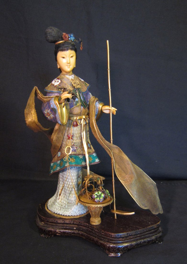 A Chinese Silver, Ivory, and Cloisonne Lady
