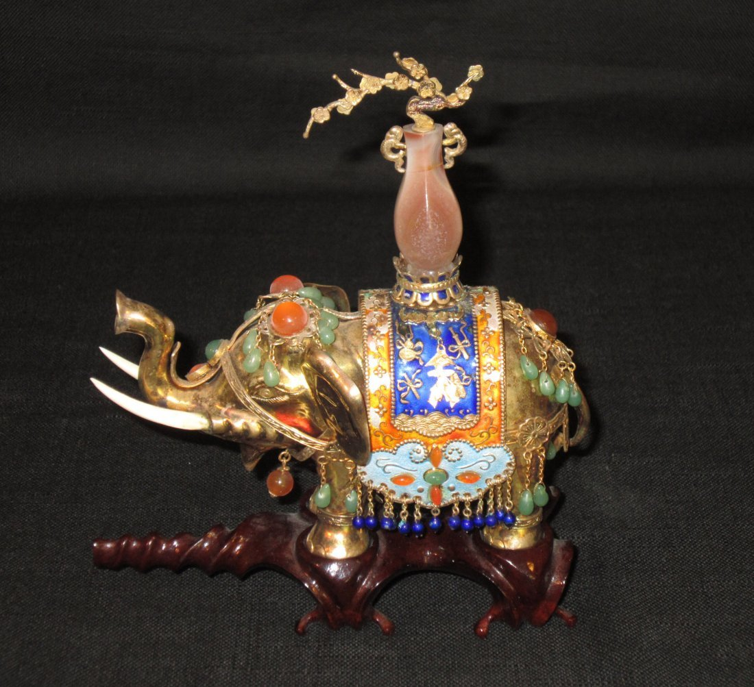 A Chinese Gilt and Enamel Silver Elephant
