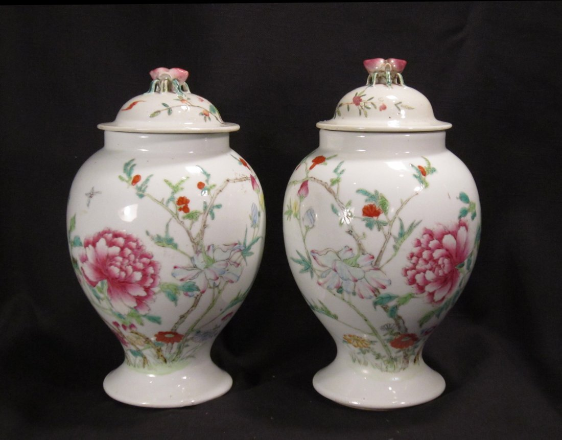 A Pair of Chinese Famille Rose Vases and Cover